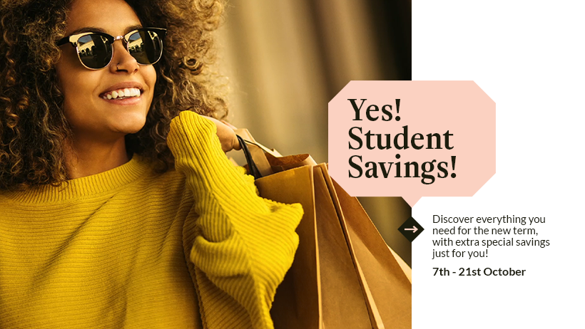 Student savings header - smiling dark haired model wearing sunglasses and a yellow jumper with shopping bags